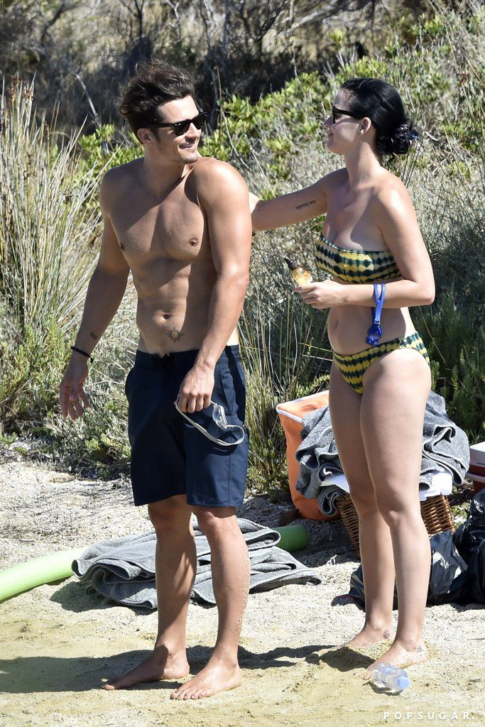 Orlando and Katy were spotted doing normal-people beach things, and Orlando also went totally nude for part of their day.