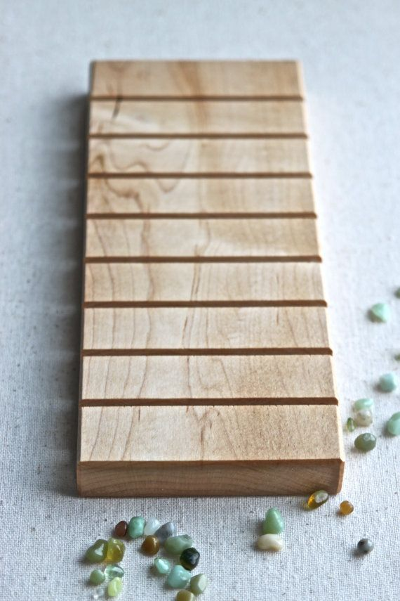 This natural wood display board is now offered in a light toned MAPLE wood. WE are super excited about this new species of wood that is offered