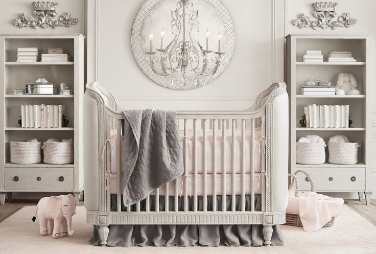 The luxurious pairing of the Belle Upholstered Crib ($1,029, originally $1,299) in Antique Grey Mist and an 18th-century Venetian Cut-Glass Mirror ($749) channel a toned-down variation of Old Hollywood.