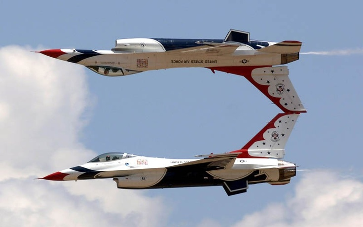 INVERTED THUNDERBIRDS   Photograph by DAVID ARMER   The U.S. Air Force Thunderbirds perform an airshow after the Air Force Academy Graduation Ceremony in Colorado.