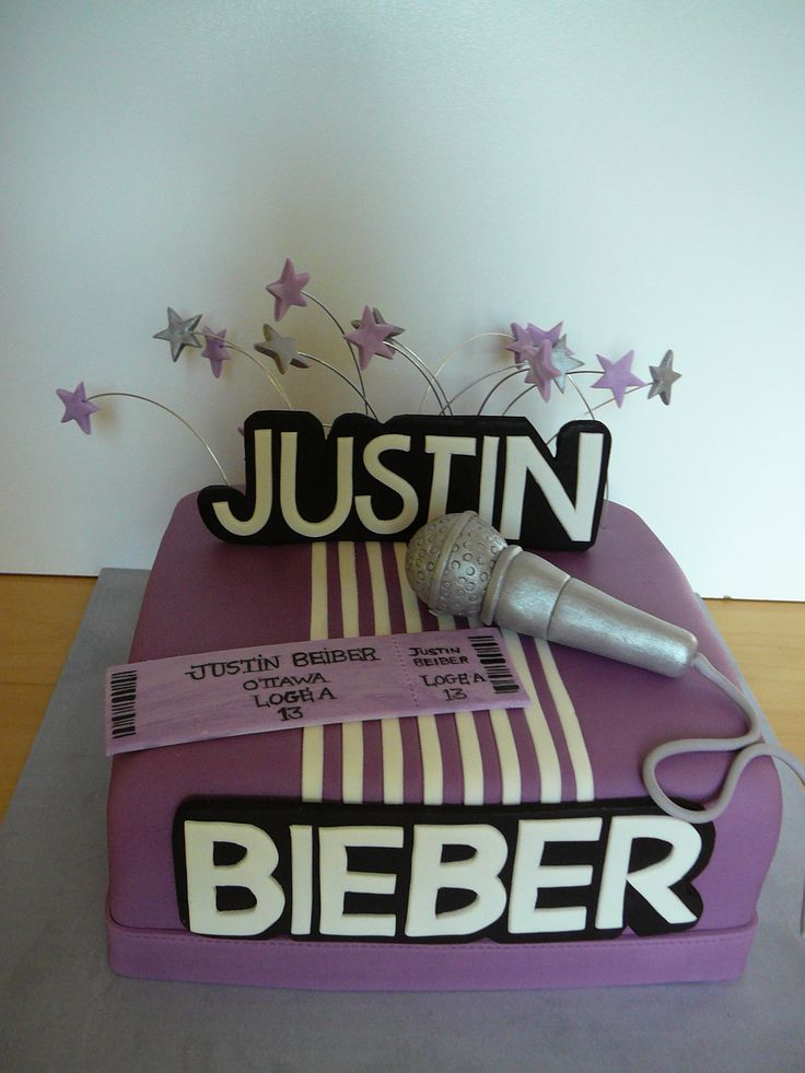 Justin Bieber - A Justin Bieber theme cake for a teenager birthday. She just got some ticket for the show and she is very excited! This is a vanilla cake with fudge caramel (sucre a la creme) filling and frosting buttercream all covered with fondant. The details are all fondant. The ticket was hand painted and the letters were cut by hand with an exacto knife.