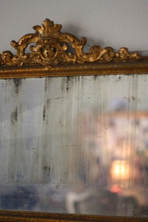 Strip a mirror from the back to age / distress / antique / ghost a mirror.