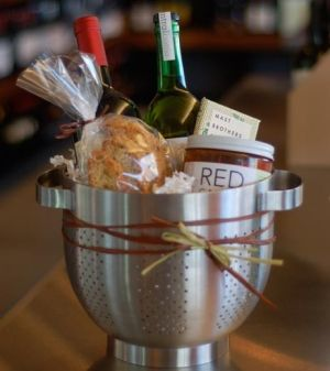 gift basket idea. I love using the colander- something practical instead of just abox that might not be reused.