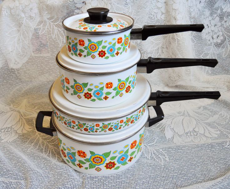 Vintage Bakelite Enameled Cookware Pot Set ; 8 pieces. Red Blue Green Orange Vintage Kitchen by Trashtiques on Etsy https://www.etsy.com/ca/listing/254139627/vintage-bakelite-enameled-cookware-pot