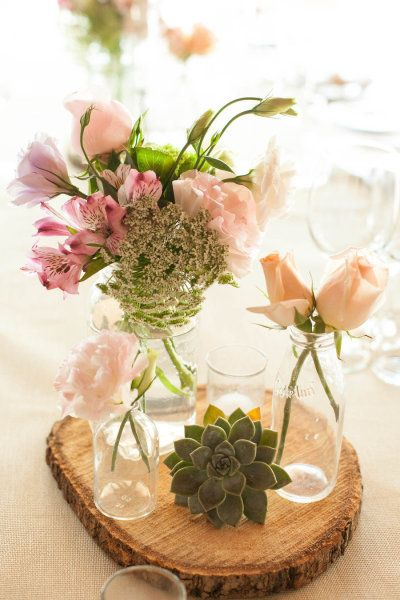 rustic centerpieces with wood coin, succulent and mismatched glass vases