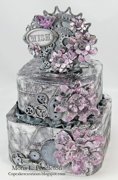 Wish.   This faux metal cake was created by Mona Pendleton.   Awesome mixed media faux metal with a steampunk flavor.   Arizona women ROCK the metal!