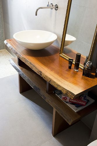 uhhhhhhh this is EXACTLY what I want in my bathroom. I LOVE rough hewn wood furniture