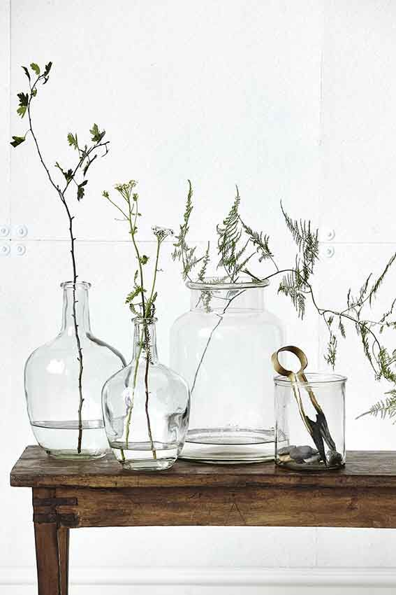large clear vases with branches