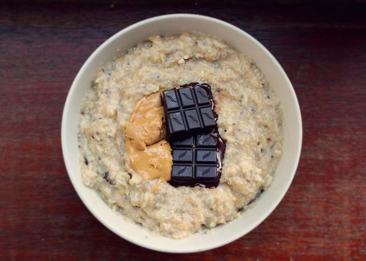 "thefreevegan: "" Oatmeal with quinoa flakes and raisins, topped with dark chocolate and peanut butter """