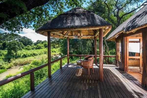 Spend the afternoon relaxing beside the pool or watching the game from your private deck before being whisked away on a late afternoon safari in an open game drive vehicle.