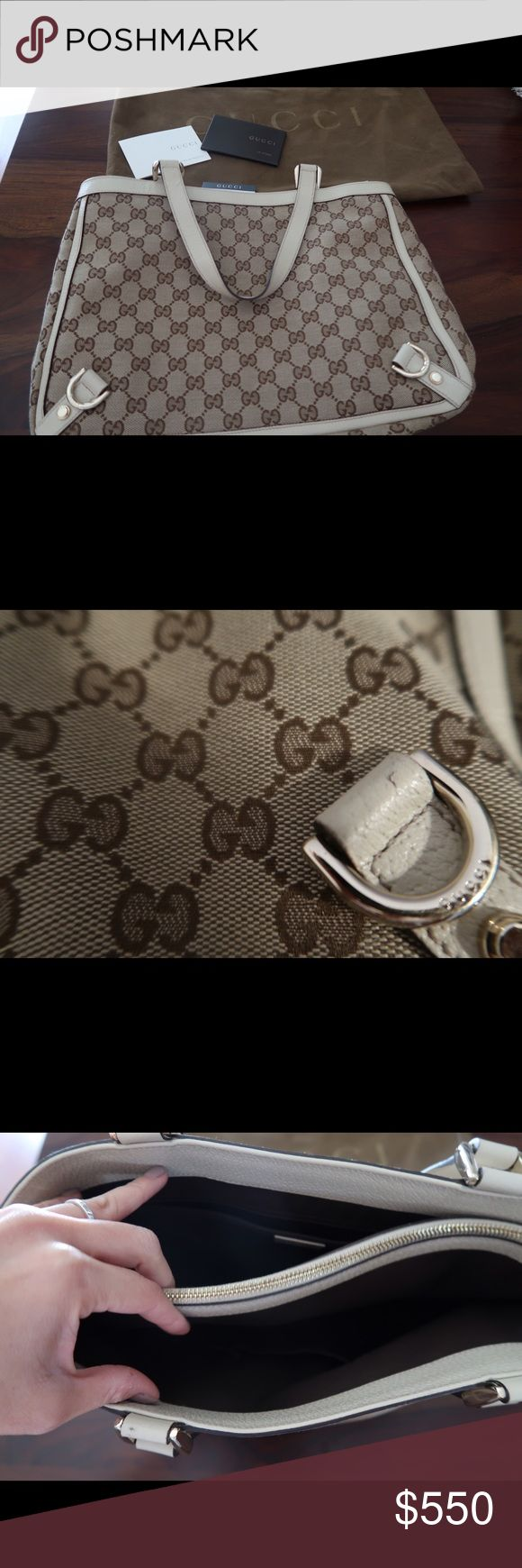 Authentic white signature monogram Gucci tote Gucci signature monogram tote with Classic GG canvas fabric. This bag was gently used 2-3 times with almost no signs of wear.  There is one tiny nick in the leather on the handle as shown in the photo.  Beautiful bag in excellent condition. Gucci Bags Totes