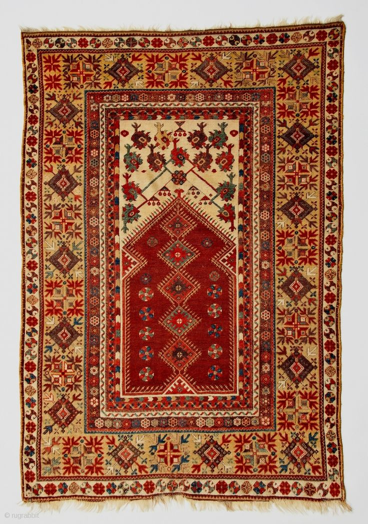 Classic early 19c Anatolian Milas prayer rug with amazing wool, refined drawing and harmonious palette including a luscious aubergine.