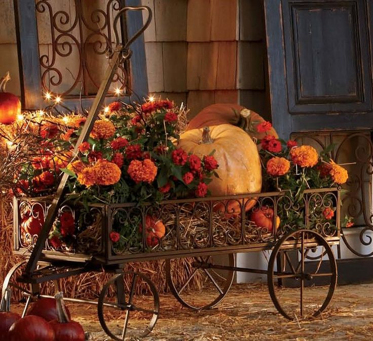 Autumn Flower Wagon...filled with mums & pumpkins for all your fall holidays.  countrydoor.com