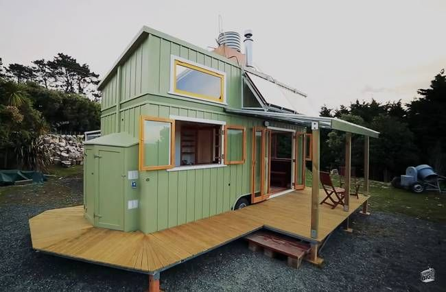 ​The salvaged wood details are   the real showstoppers though​, along with the fact that the owner is now off the grid as all she needs is completely self-contained in this tiny house! The site has a video of Living Big in a Tiny House episode that includes a tour of the house!  Check it out!