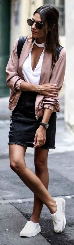 A blush pink bomber + perfect crossover + edgy and feminine chic + distressed black denim skirt + sneakers + Federica L. + gorgeously androgynous look   Bomber/Skirt: Missguided.