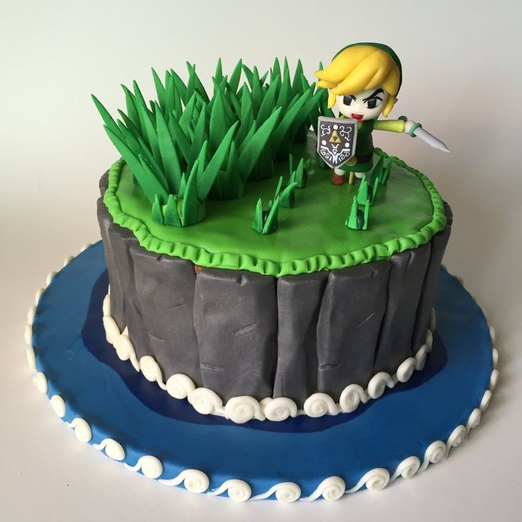 Zelda Wind Waker Cake Link enjoying cutting grass along his epic journey ! ~ 1 tier : 9'' round pan, tier composed by : 4 layers of Vanilla cake ~ Chocolate peanut butter cream frosting ~ Link Topper made of fondant and tylose standing with a bamboo stick ~ Grass, Rocks and waves made of fondant and tylose https://instagram.com/p/4MVrRDEOxs/