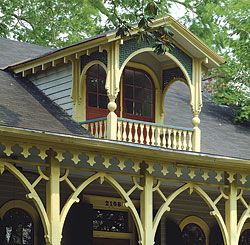 The porch upstairs: Extending the roof of a doghouse dormer provided the opportunity to duplicate the details and benefits of a main-level porch. This house stands out in the historic Garden District neighborhood of New Orleans, where many other examples of Southern Victorian architecture exist.