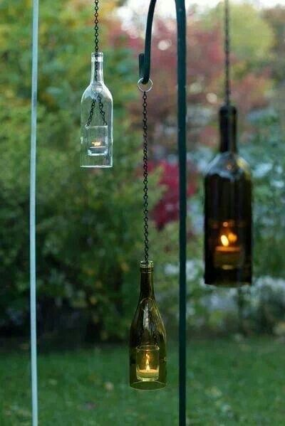 Wine bottles. Cut bottom out - hang with chain and wire ring. Makes great laterns