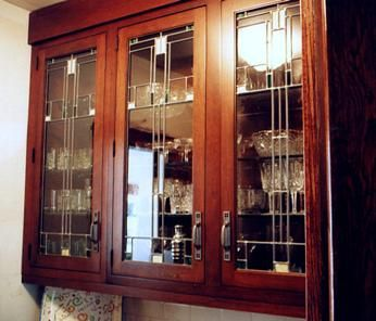 Simple but elegant new glass in the butler's pantry cabinet doors in a Craftsman-style home in Glen Ellyn, IL.