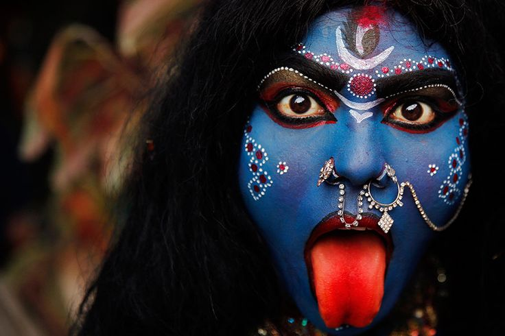 "Indian woman dressed as the Hindu Goddess Kali participates in a ""Shivratri"" procession in Allahbad, India.  ""shivratri""' or the night of Shiva , is dedicated to the worship of Lord Shiva, the Hindu god of death and destruction.  Rajesh Kumar Singh/AP  Photos of the day 2/27"