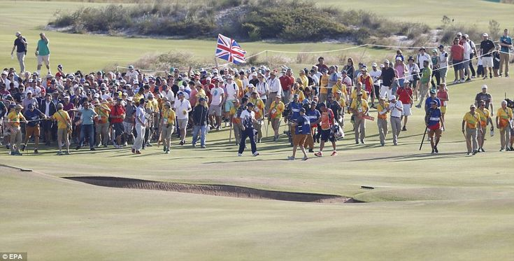 The large crowd watches on as Rose walks down the 18th fairway on the final day of the men's golf.  Golf attracted one of the largest crowds at the Rio Olympics.