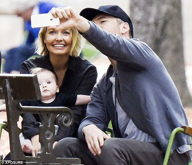The money shot: Sam Worthington took a family snap with wife Lara Bingle and their five-mo...