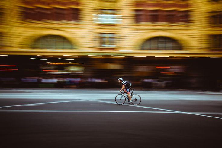 Cyclist outside Flinders Street Station -William Watt