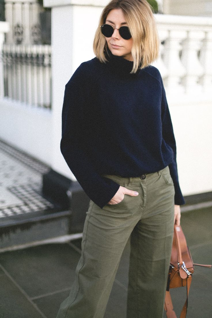 Emma Hill style, spring uniform, house of fraser, navy high neck jumper, round ray ban sunglasses, khaki trousers, tan loewe puzzle bag, spring fashion, casual outfit