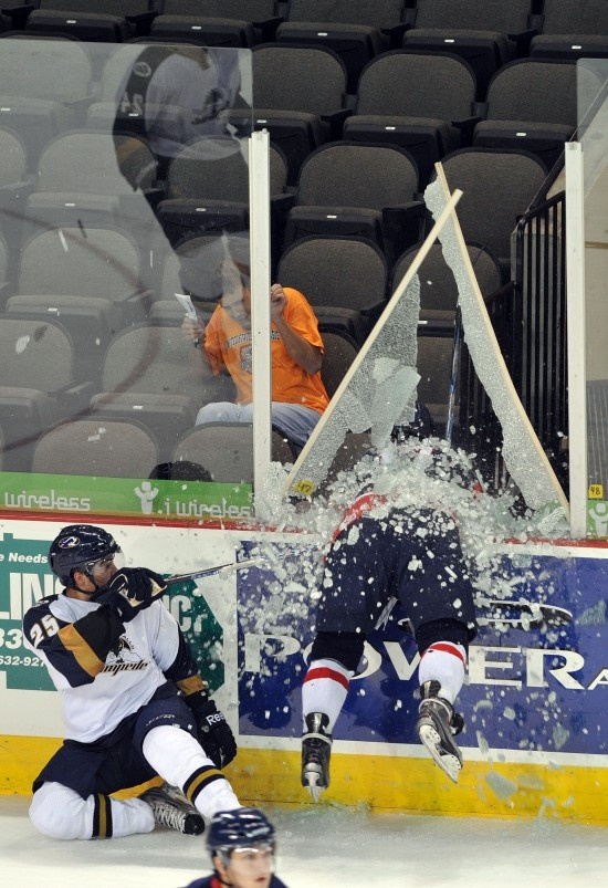 ❤ Hockey (Patrick Kirtland of the Des Moines Buccaneers goes right through the glass during the 2010 USHL Fall Classic.)