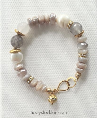 I'm in love with everything about this bracelet * Gorgeous faceted rondelle Raw Moonstone - the colors of the moonstone are just beautiful. Soft and feminine. It's highlighted with Fresh Water Pearl Nuggets and Gray faceted quartz. * This strung bracelet is secured with a 14kt. gold hookset, and gold tone findings. * Finished length: 8