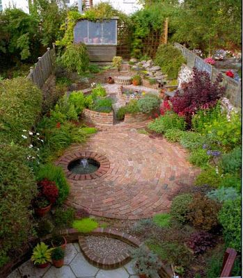 Repetition of hardscape shapes adding rhythm to a small space and setting each area apart for specific function.