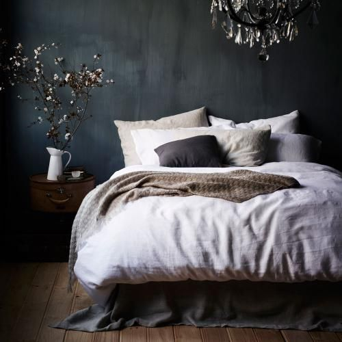 Vintage Washed Linen Bedlinen Current. Love the drama of the black wall & chandelier mixed with neutrals & the earthiness of relaxed linen.