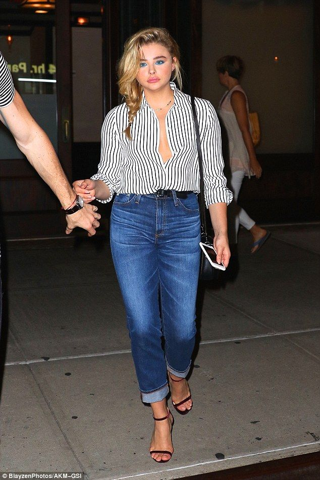 Can't touch this: Chloe Moretz seemed to be in great spirits as she showed her ex-boyfriend exactly what he was missing in a plunging striped shirt on Wednesday
