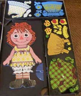 I had this one and how sad is it that I am excited to see this photo?!  LoL!   I had forgotten all about my Raggedy Ann Colorforms.