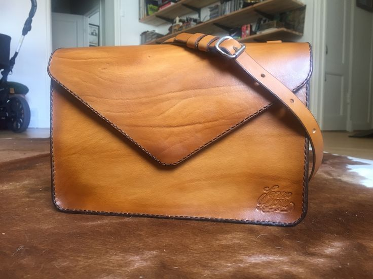The product • Envelope Bag Large Walnut • is sold by • Jenny Lou Store • in our Tictail store.  Tictail lets you create a beautiful online store for free - tictail.com