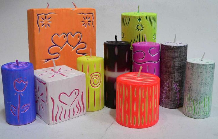 Candles w carved designs through to inner color layer