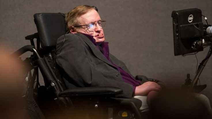 """File photo: April 9, 2013: British cosmologist Stephen Hawking, who has motor neuron disease, gives a talk titled """"A Brief History of Mine,"""" to workers at Cedars-Sinai Medical Center in Los Angeles.  (AP Photo/Cedars-Sinai, Eric Reed)"""
