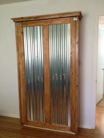Murphy Bed   Do It Yourself Home Projects from Ana White  Like the corrugated tin...doubles as a magnet board.