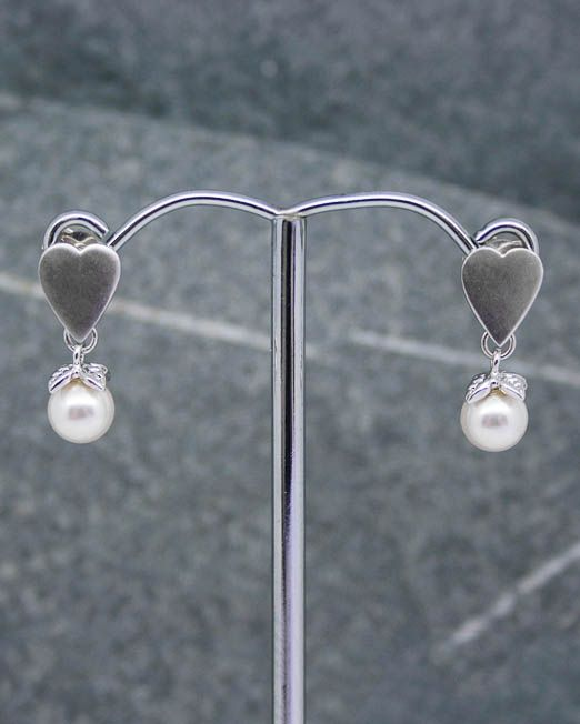Heart and swarovski pearl drop earrings.  The heart measures  8mm x 10mm and the pearl measures 6mm.  They are set into rhodium plated fittings with 925 silver posts and scrolls.  #Earrings #Heart #Pearl #Portside