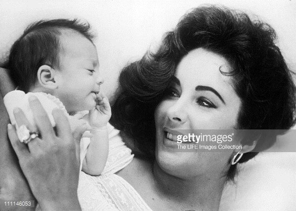 Actress Elizabeth Taylor with her baby daughter Elizabeth Frances Todd, 1957. Description from gettyimages.be. I searched for this on bing.com/images