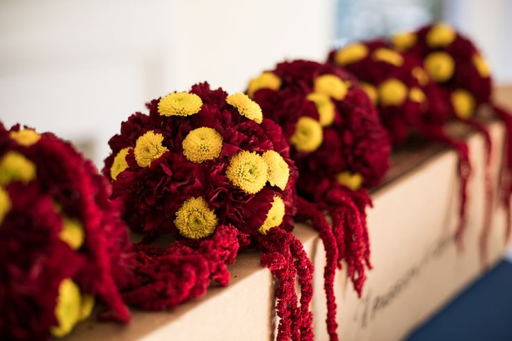 Our bride used gold and burgundy colored flowers along the ...