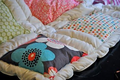 Sew material on a down comforter.
