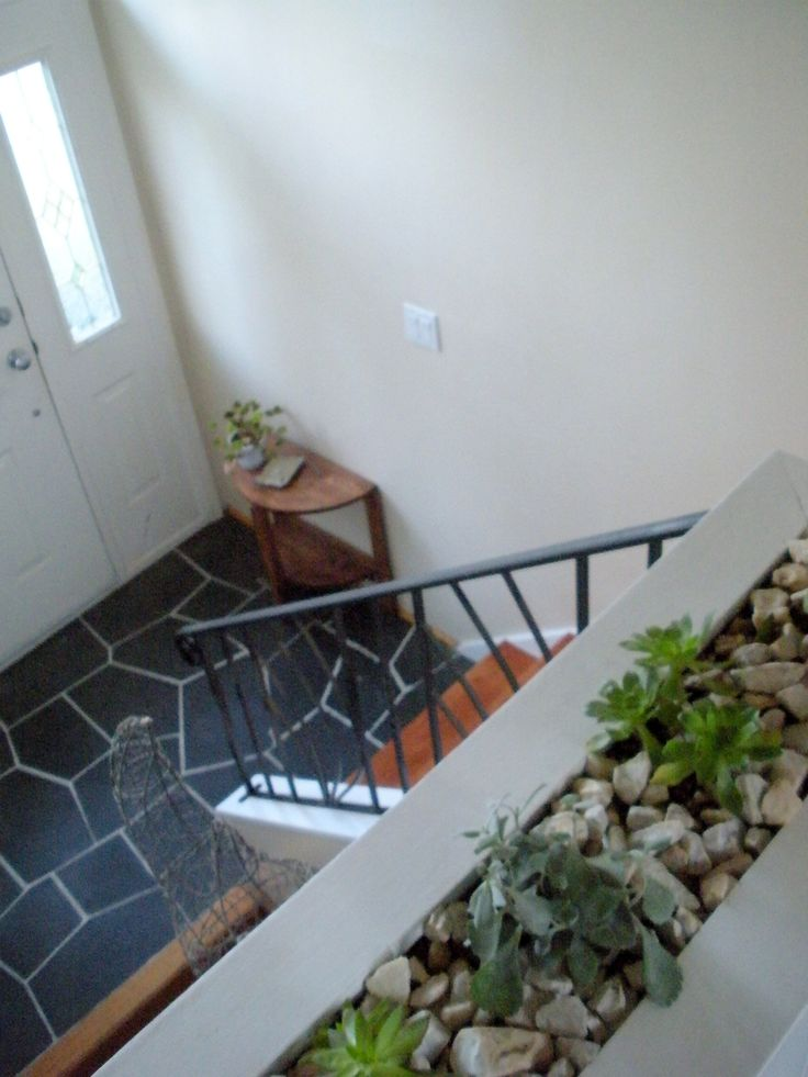 built in booxshelf/planter, slate tile entry, and iron railings in our entry and upper hallway- Sarah V @ CraftyWaffles