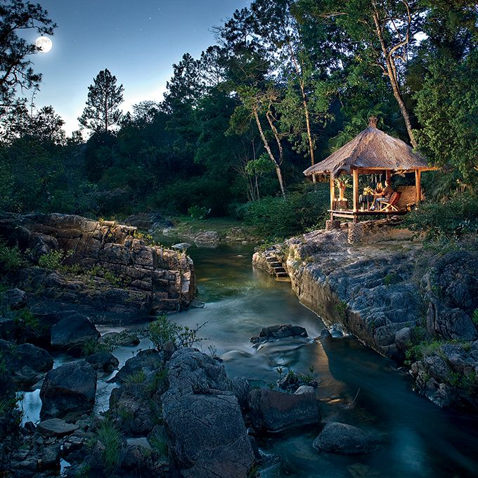 Brides.com: . Blancaneaux Lodge, Mountain Pine Ridge Forest Reserve, Belize. Owned by Francis Ford Coppola, this clutch of thatch-roofed huts on a remote, jungly mountainside was built for maximum access to nature. Many have outdoor showers, and all have sprawling private decks within sight (or sound) of Privassion Creek and its waterfalls. After canoeing to a cave where Mayans once performed rituals or horseback riding through the rain forest, guests cool off in a nearby swimming hole or…