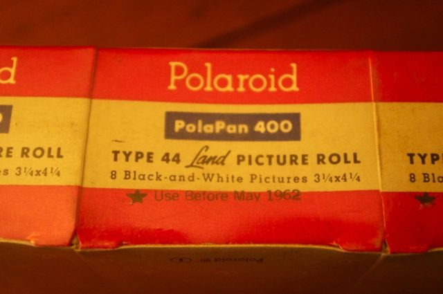 a brick of three rolls of Type 44, still sealed in the factory cellophane.