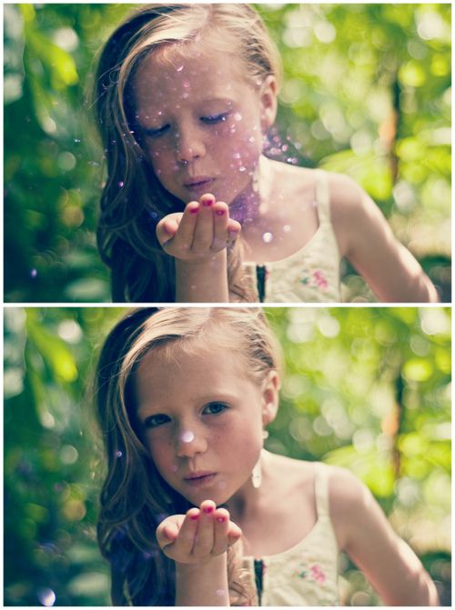 a small person blowing glitter