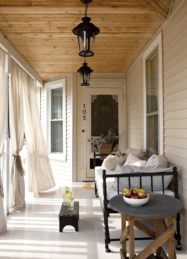 Ana Rosa ...beautiful porch with what looks like an iron frame daybed :)