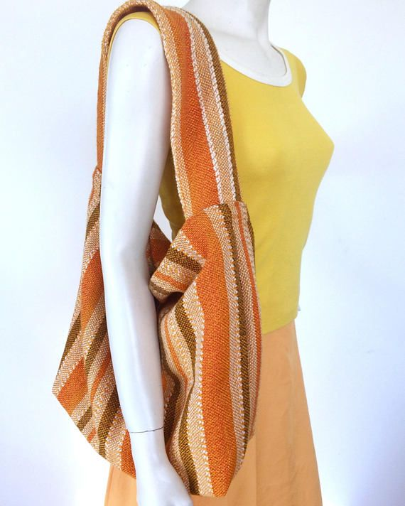 That 70s Orange  upcycled boho bag made from vintage orange 70s curtains, with a gorgeous texture in the weave. Fully lined with vintage fabrics, washable, and reversible.  #vintage #fabric #print #upcycle #orange #70s #retro #texture #weave #stripe #curtains #fashion #accessories #bag #boho #hobobag #handbag #tote