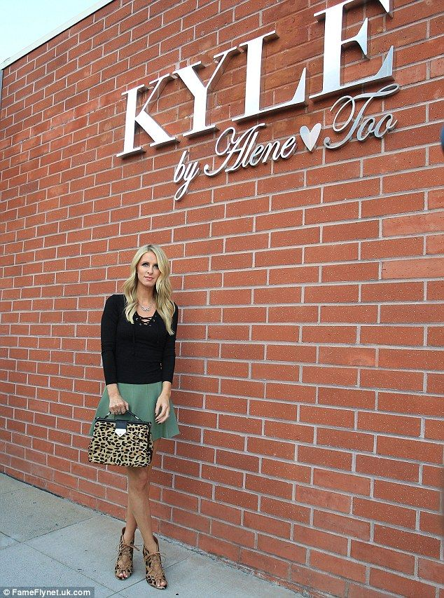Picture perfect: Nicky stopped to pose in front of reality star Kyle Richards' store, Kyle...