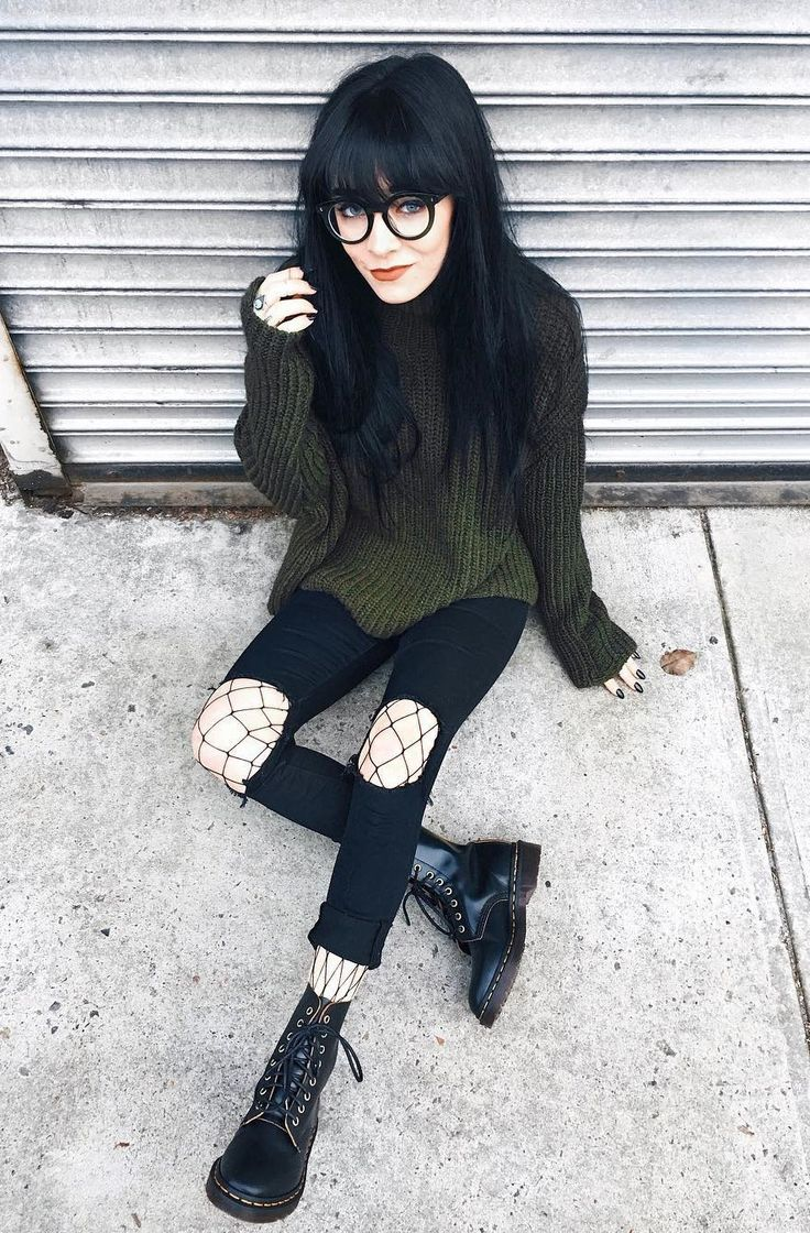 Glasses with green sweater, ripped black pants, fishnet ...